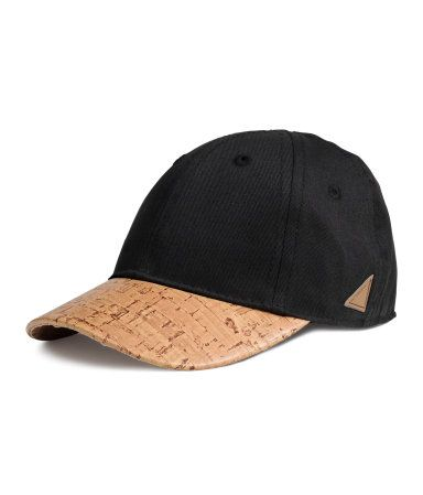 Cotton cap with elastication at back.