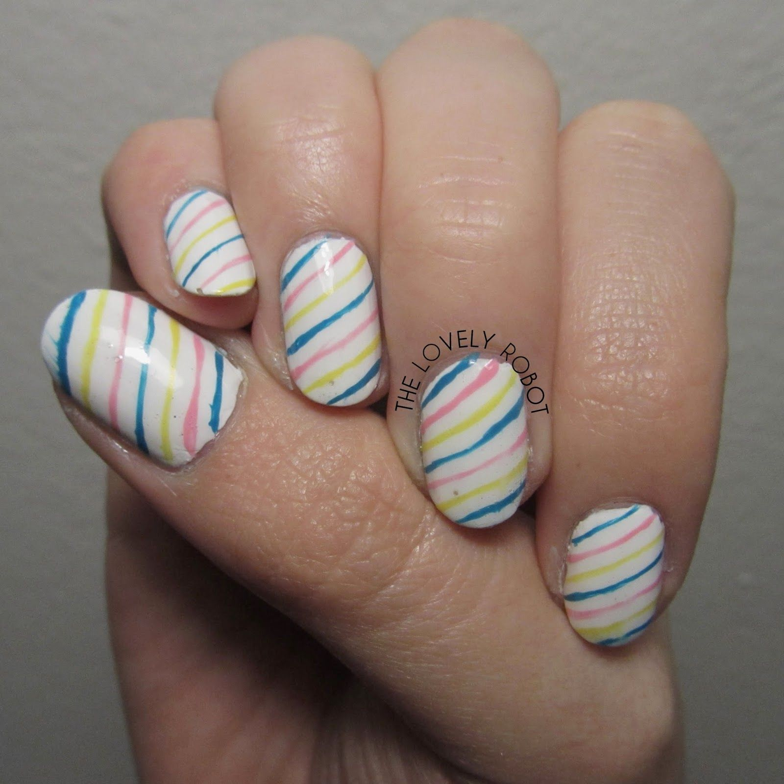 Concrete And Nail Polish Striped Nail Art: Freehand Blue, Pink And Yellow Striped Nails For Tri