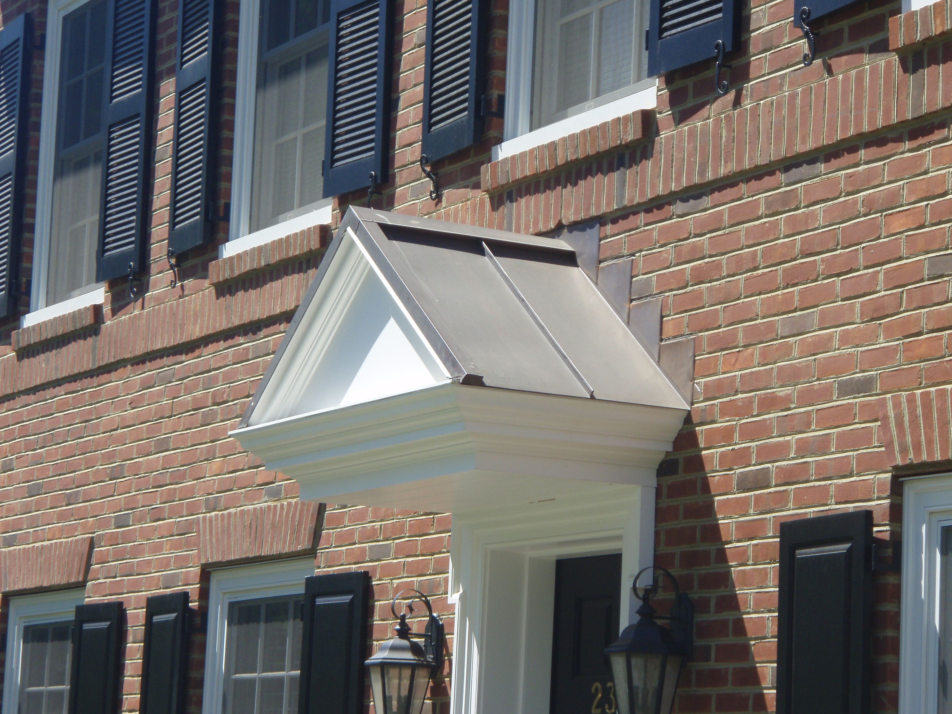 Slightly Aged Copper A Frame Standing Seam Roof Over Door Way Dutch Gable Roof Architectural Shingles Metal Roof Cost