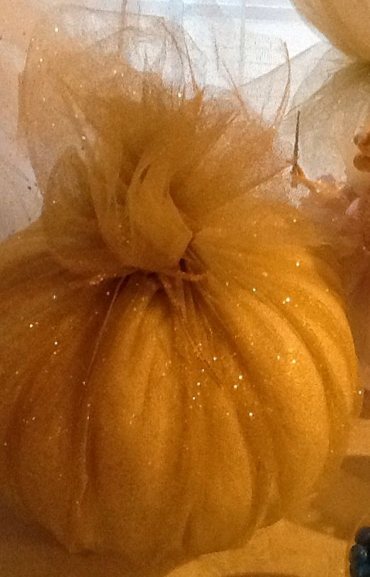 Pumpkin wrapped in gold shimmer tulle Lovely Fall decorating idea