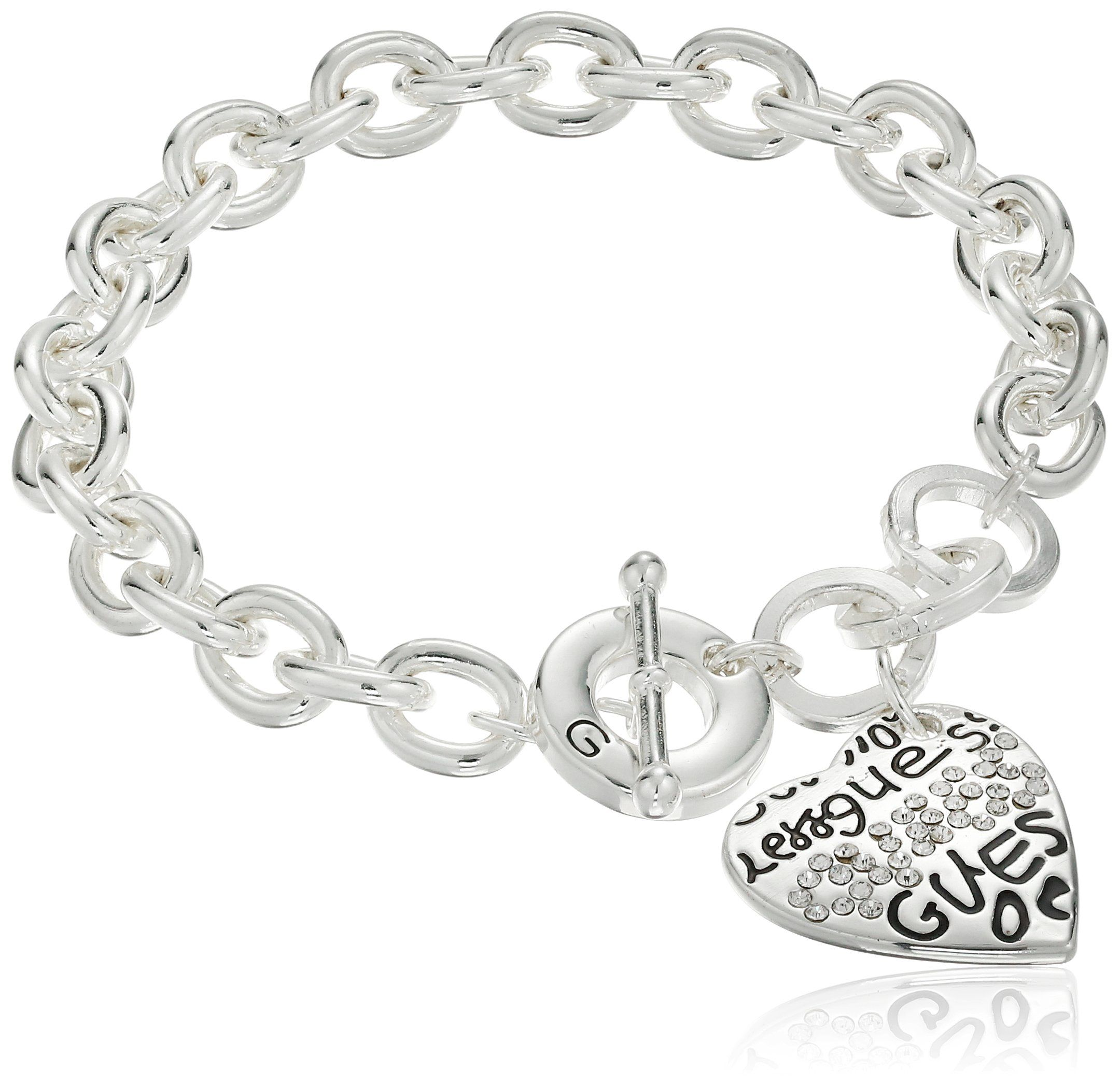 """GUESS """"Basic"""" Silver and Crystal Graffiti Heart Toggle Charm Bracelet Charm 1"""" H x 0 8"""" W Made in China Silver Metal Logo Heart Charm Bracelet"""