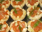 Norwegian smoked Salomon with dill sauce and capers in mini fillo shells