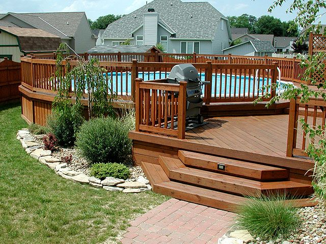 Multi level deck with above ground pool around the house for Multi level deck above ground pool