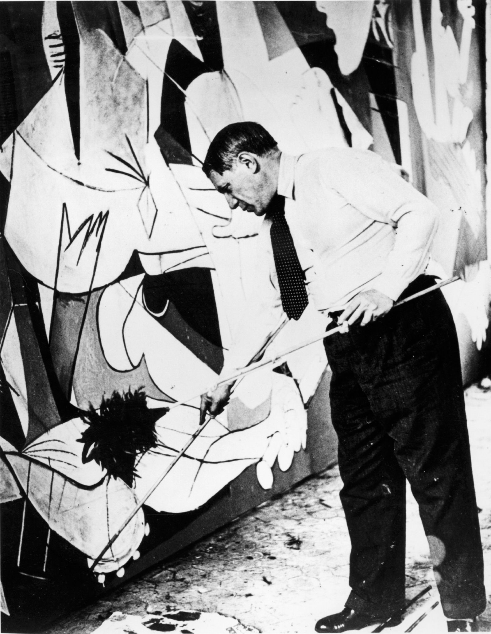 A different guernica john richardson pablo picasso painting guernica in his studio paris 1937 photograph by dora maar