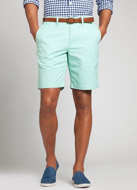 Mint green flat front khaki shorts, slim cognac belt, gingham shirt. Clean cut and effective