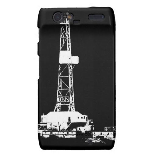 Silhouette of a drilling rig working in the oilfields above