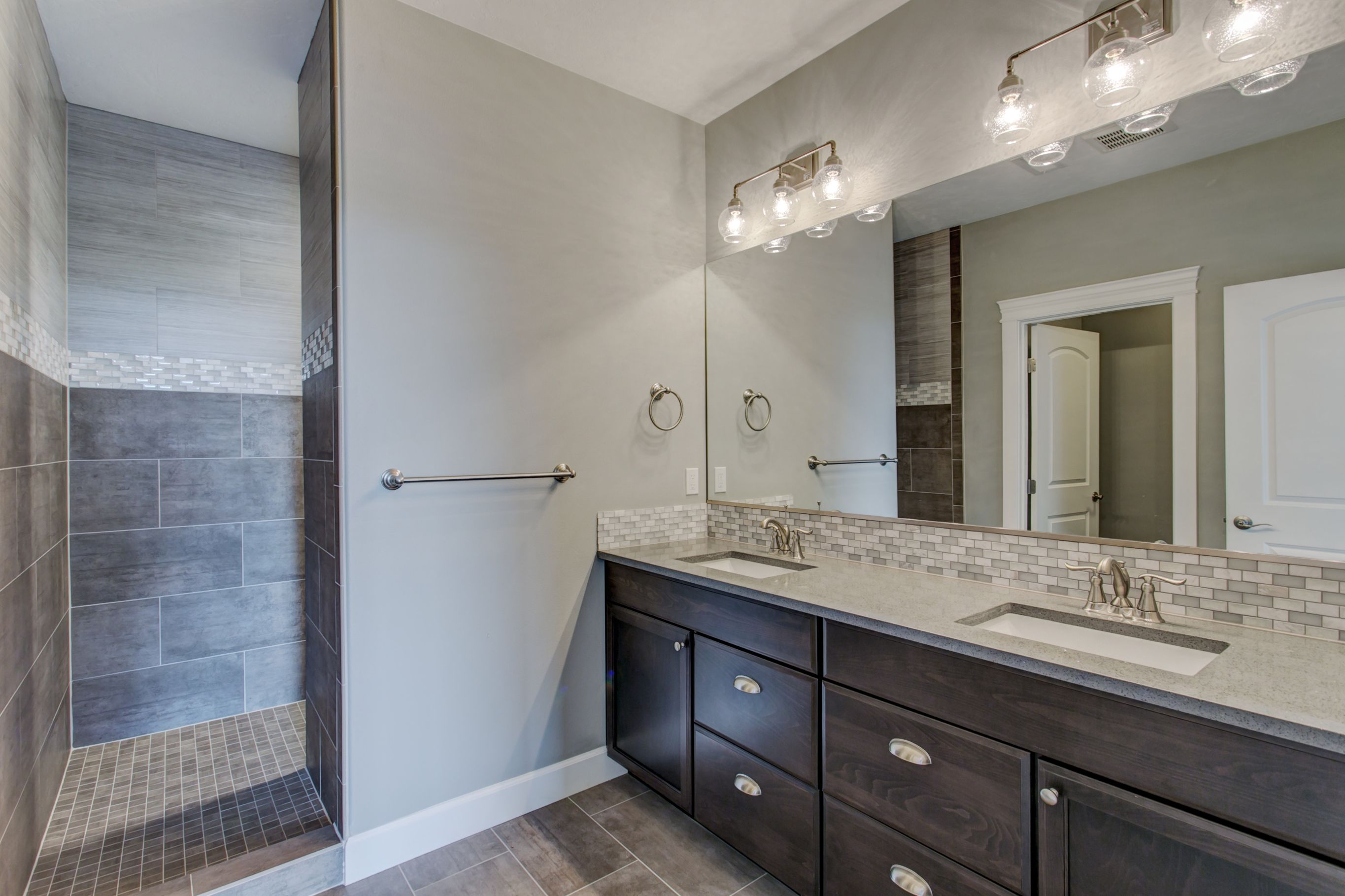 This master bath makes use of four different tiles which seems like a lot