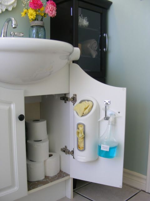 Hang bathroom cleaning supplies on inside of cabinet door for quick