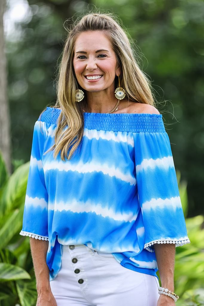 Lockley | $36 Off-the-shoulder tops are so unique and sexy! Lockley is a beautiful off-the-shoulder tie dye top that screams summer! It has a unique tie dye pattern that is bound to catch everyone's eyes. #tiedye #tiedyetop #tiedyeshirt #bluetiedye #summerstyle #summertrends #trendy #trendytiedye #stylish #outfit #outfitinspo #styleinspo #fashion #onlineshopping #onlineboutique #new #cute #chic #shop #summertime #asherkate #offtheshoulder