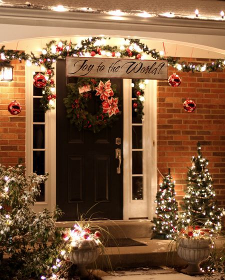 Love The Joy To World Sign Hanging In Front Of Door Outside Christmas Decorations