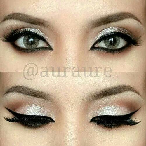 Silvery white eyeshadow with strong black liner