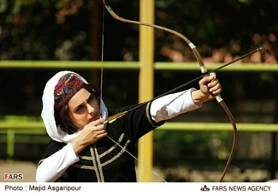 Iranian lady Archer in her lovely traditional clothing - Tehran , IRAN  Iran has many different ethnic groups each with their own lovely costumes and traditions