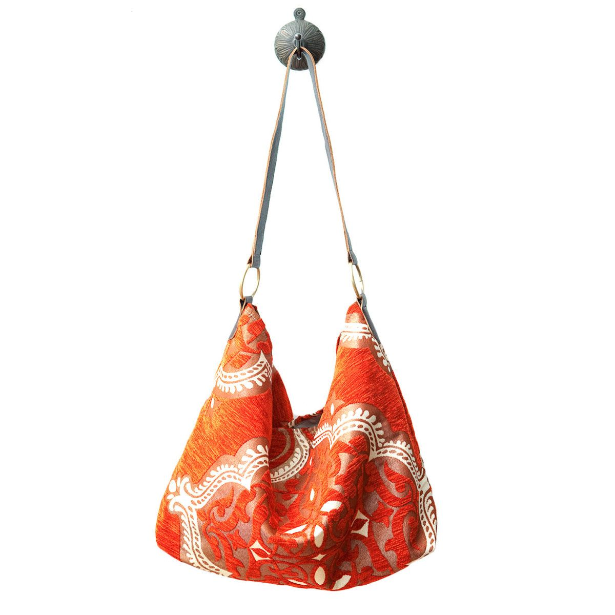 Fab.com | Hobo Bag Orange  This site sells items for Morocco to help women in that country. Check it out.