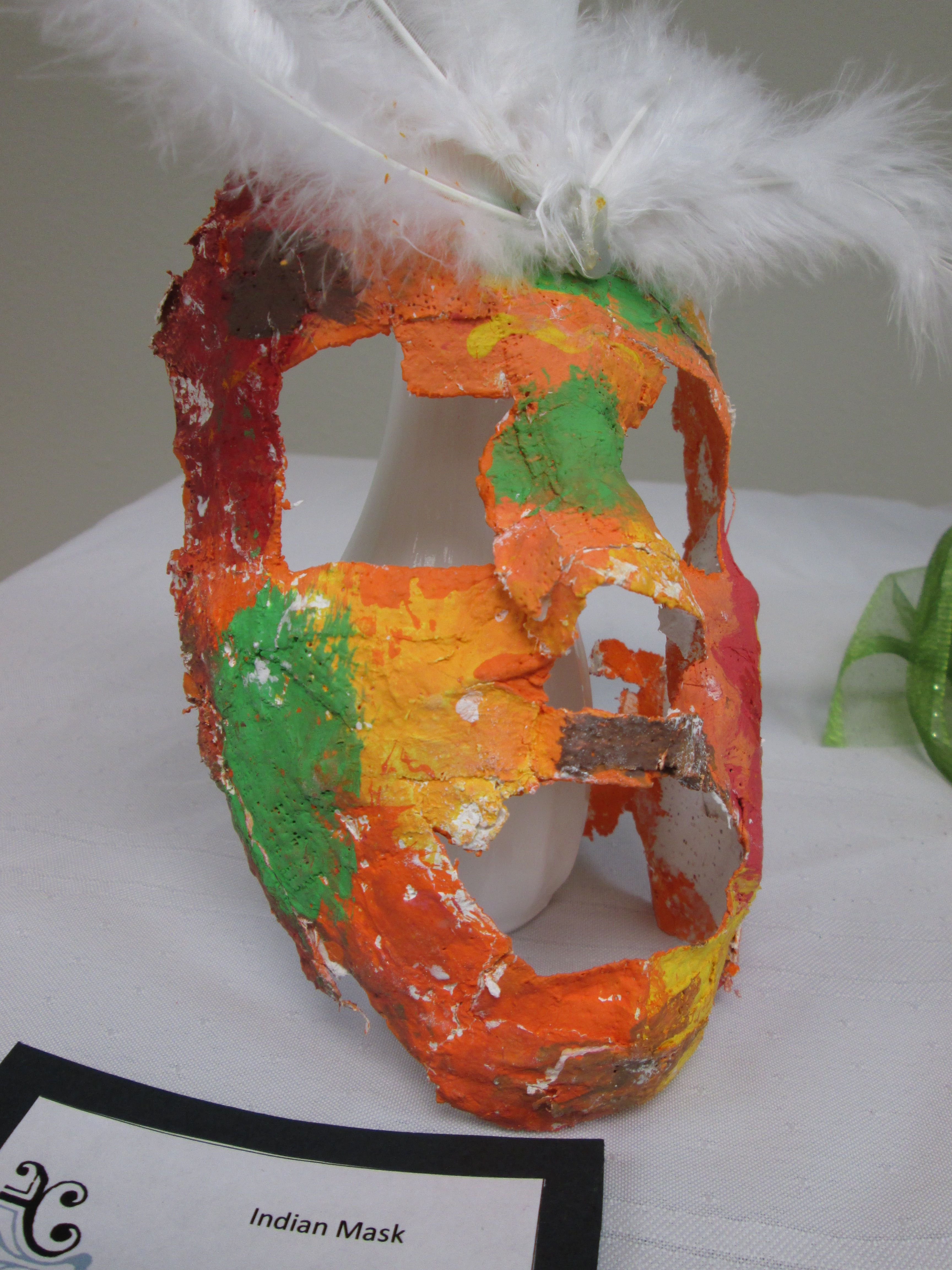 Close up of a plaster face mask displayed at AMPL's Spring 2013 Teen Art Exhibit Opening.