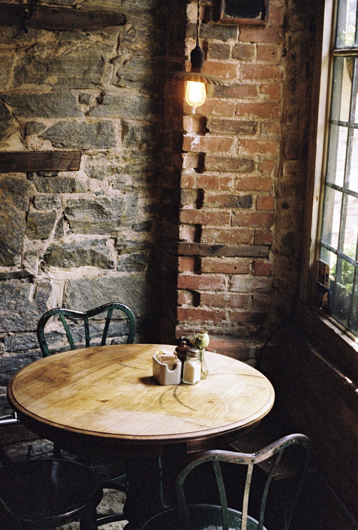 cafe dining area. exposed brick + intimate seating + reclaimed