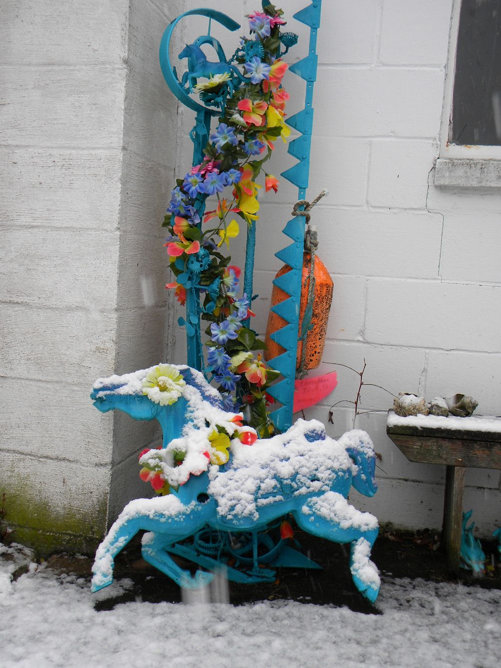 """my dad's """"junk sculpture"""" rescued with Rustoleum 2X, bouncy Wonder Horse rescued from trash (painted with Rustoleum 2X), silk flowers, bass buoy from Chincoteague Is.... might have changed this to evergreens, but... nope"""
