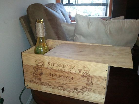 Decorative Wooden Wine Box with Wine Bottle (gift cards?)- The wooden wine box is authentic and from an actual winery, includes the sliding top cover. The wine bottle is green, with clear stones inside and a string of lights. The wine bottle is decorated with a twine neck. The wine box has a tiny hole drilled into the side for the electric cord to run through.