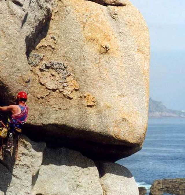 rock climbing with a sea view