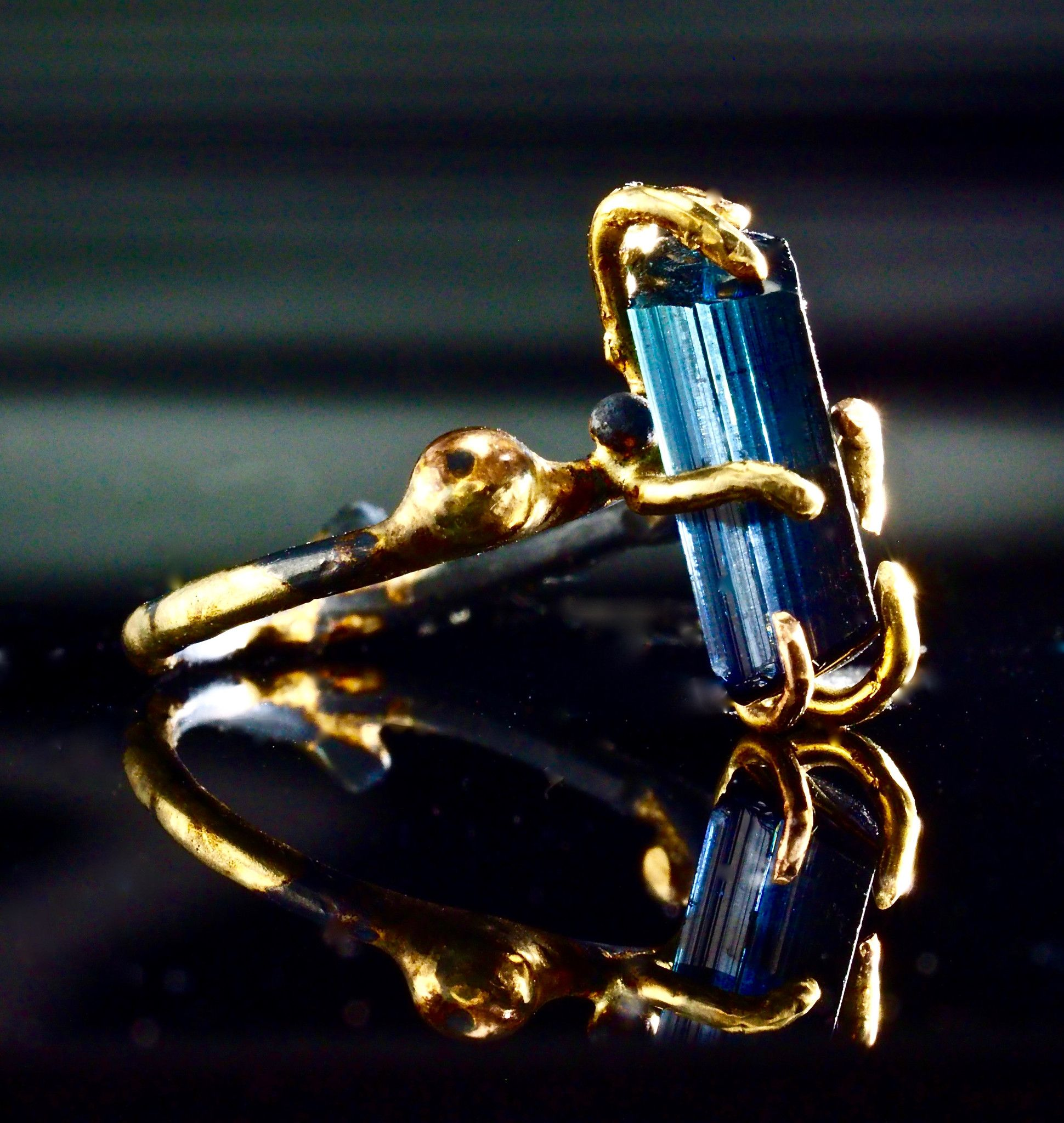 Blue indicolite tourmaline on solid k gold and oxidized sterling