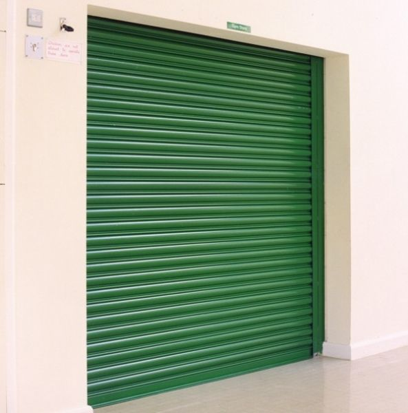 The Seceuroshield 750 Security Shutter Is The Classic Steel Roller Shutter The Scrolled Slat Profile Is A Fam Security Shutters Solid Curtains Shutter Designs