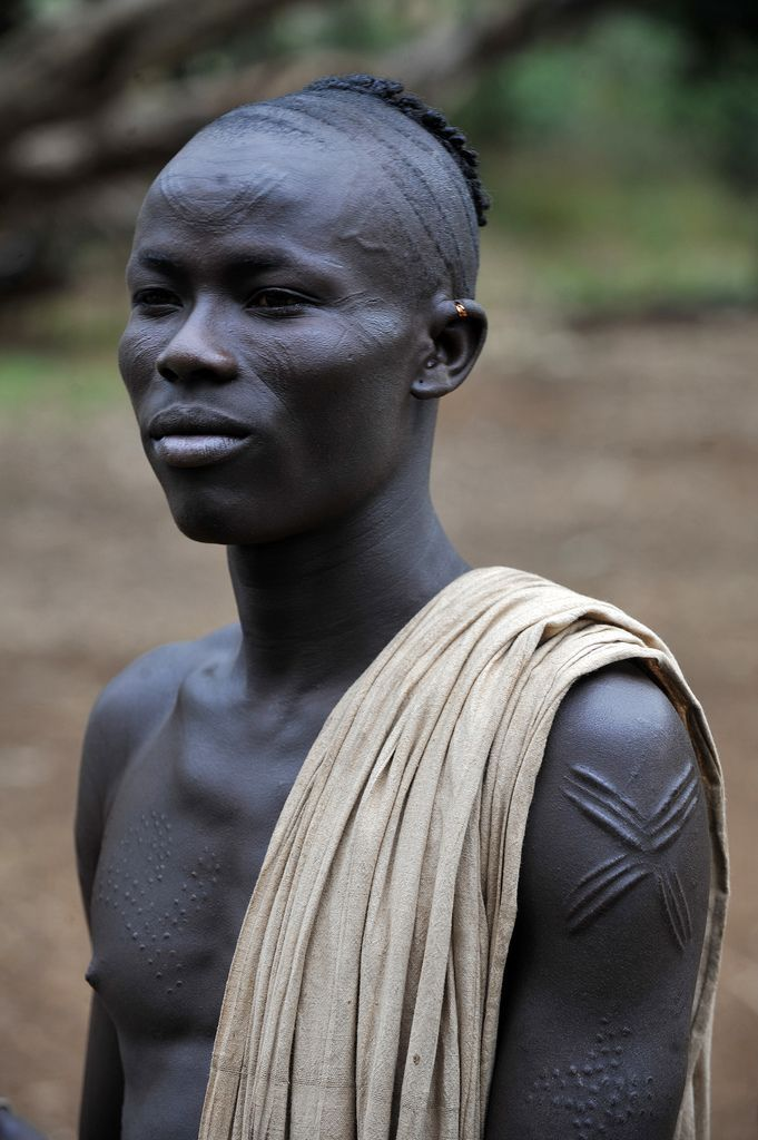 Kachipo young man with scarifications and typical