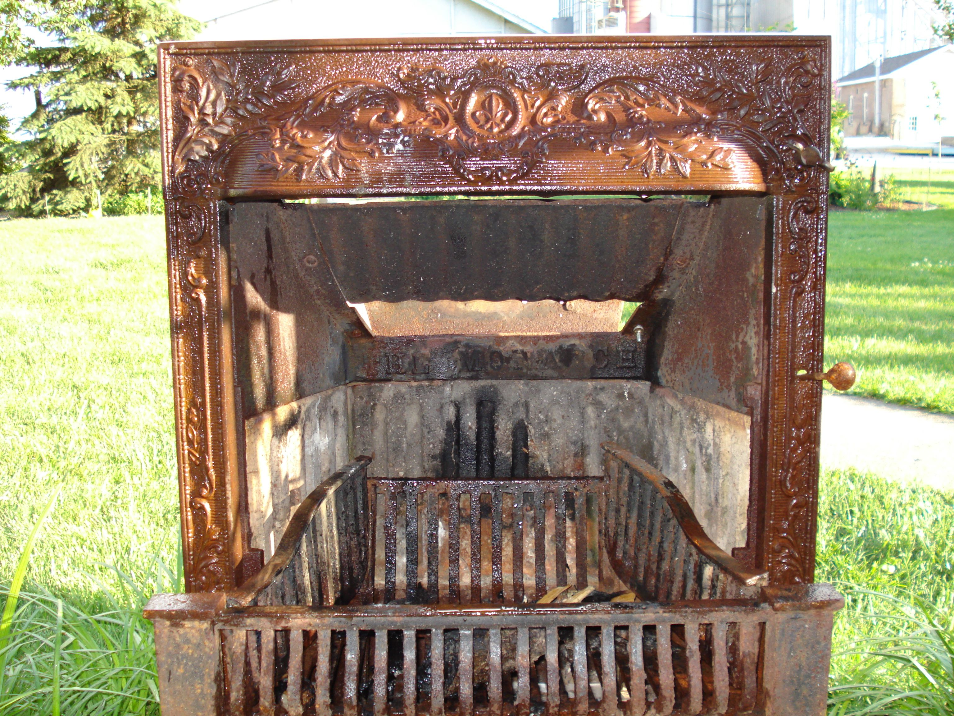i would love to find an old fireplace insert to use as an outdoor