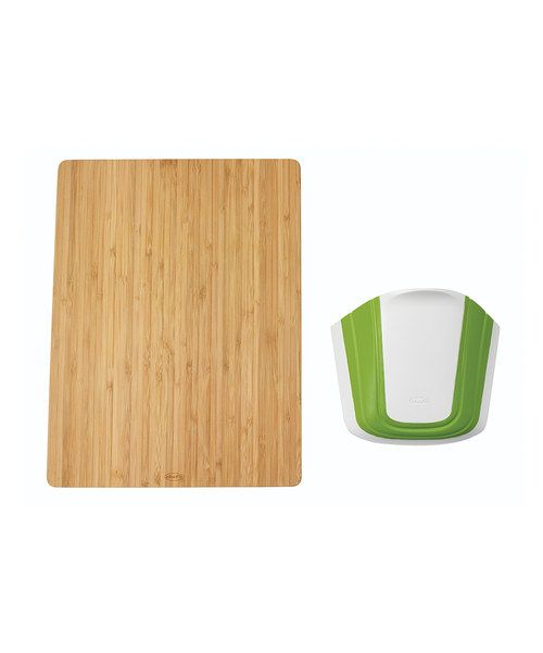 This three-in-one cutting board boasts a built-in colander and transfer tray that slides in and out for easy storage and cleanup.Includes cutting board, colander and trayBoard: 10.85'' W x 14.6'' HWood / plasticHand washImported