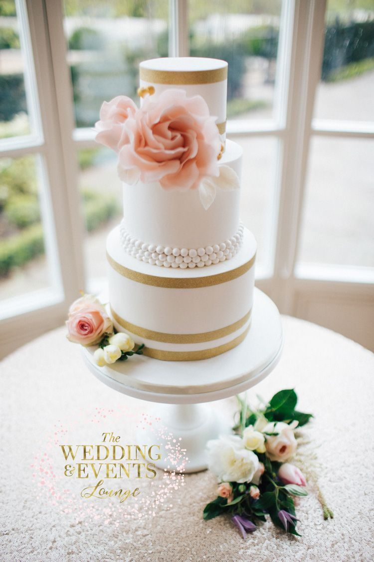 simple and elegant 3 tier white wedding cake with gold and blush ...