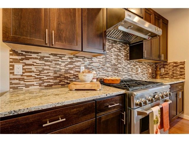 the cabinets are stained in java and the kitchen has full tile backsplash appliances are on kitchen cabinets java id=77954
