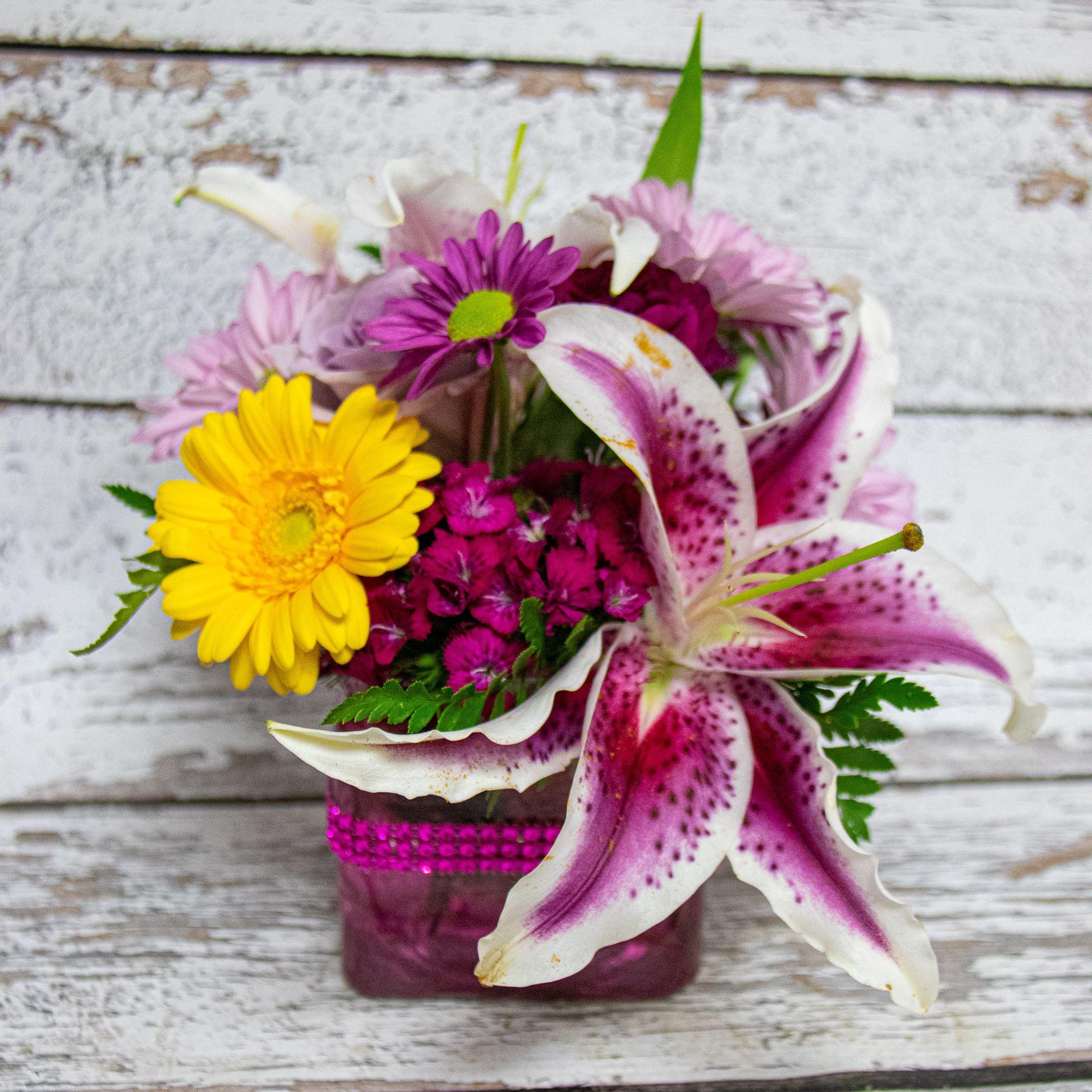 Lilies in pink flower delivery flower arrangements