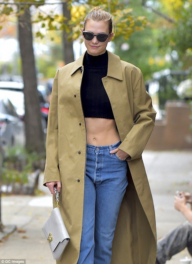 Rock hard! The 24-year-old supermodellooked runway ready as she flaunted her washboard abs in a black crop top and a pair of denim pants which rested below her belly button