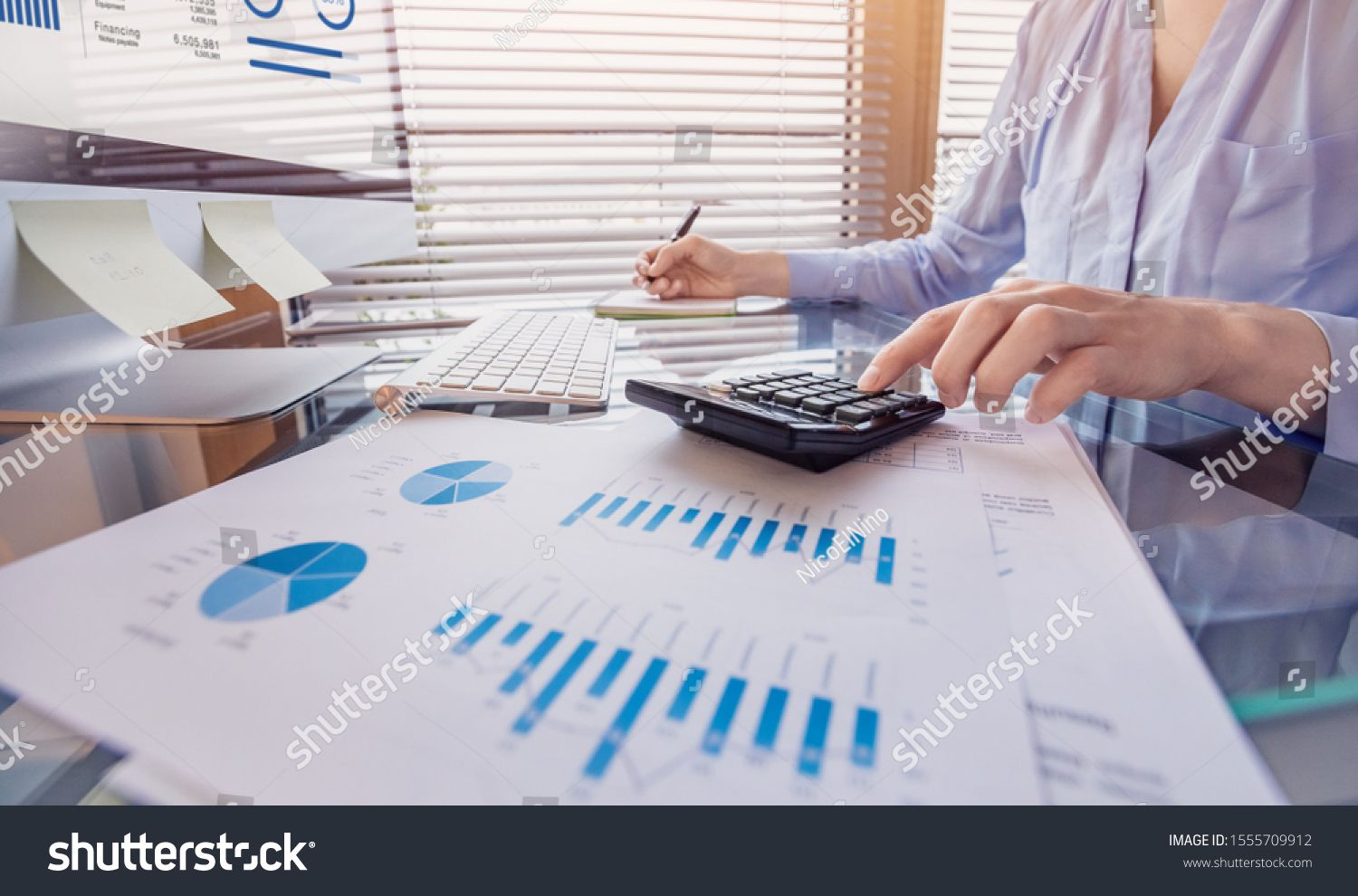 Business Person Working On Financial Report And Analyzing Revenue And Expenses Data With Calculator In Office Roy Business Person Financial Statement Financial