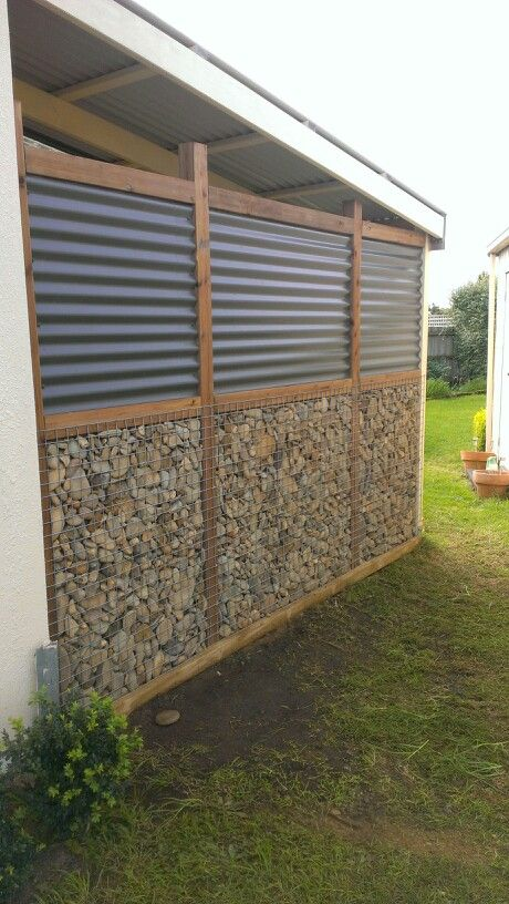 River stone and colorbond fence at my place | Garden ...