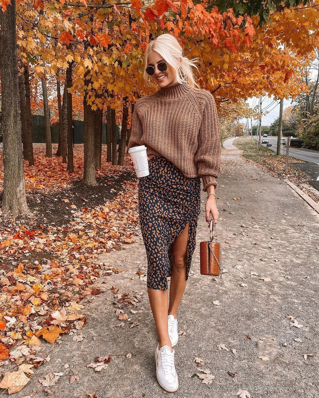 Photo of Trendy abstract leopard print slit skirt with cozy taupe sweater.