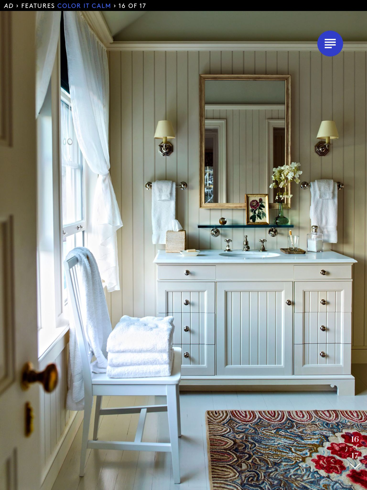 Two sconces over two hand towel bars with glass shelf over sink ...