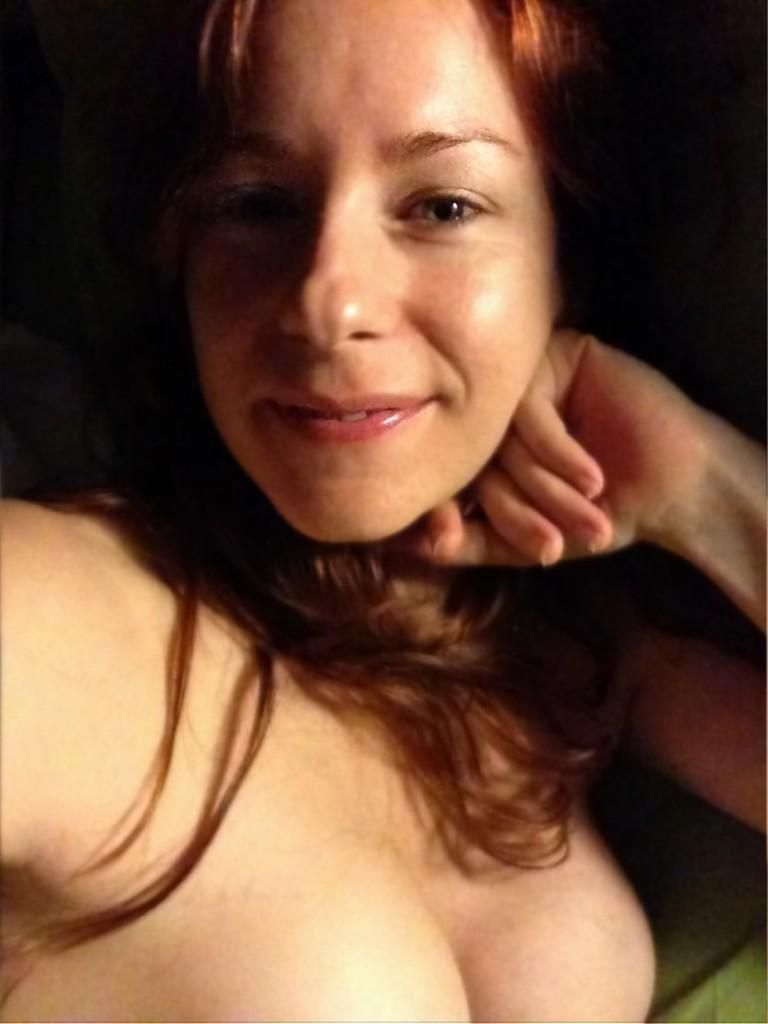 Camille Crimson Relaxing In Bed