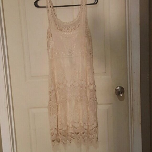 Cream sheath crochet dress with scalloped bottom NEW WITH TAGS. CREAM/IVORY CROCHET SLEEVELESS SHEATH DRESS WITH SCALLOPED BOTTOM. VERY CLASSY DRESS, PERFECT FOR ANY OCCASION AND IS GORGEOUS FOR PHOTO SHOOTS! MSRP $100+ COMES FROM PET FREE, SMOKE FREE HOME! ANY QUESTIONS JUST ASK! Dresses Midi
