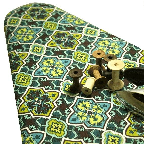 Ironing board cover for laundry room...blue/brown with some green...