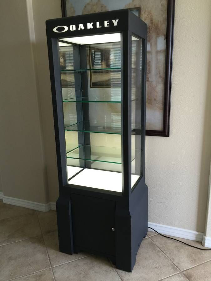 ce56a4d04764 Oakley Sungalsses Retail Display Case. Four glass shelves with lighting.