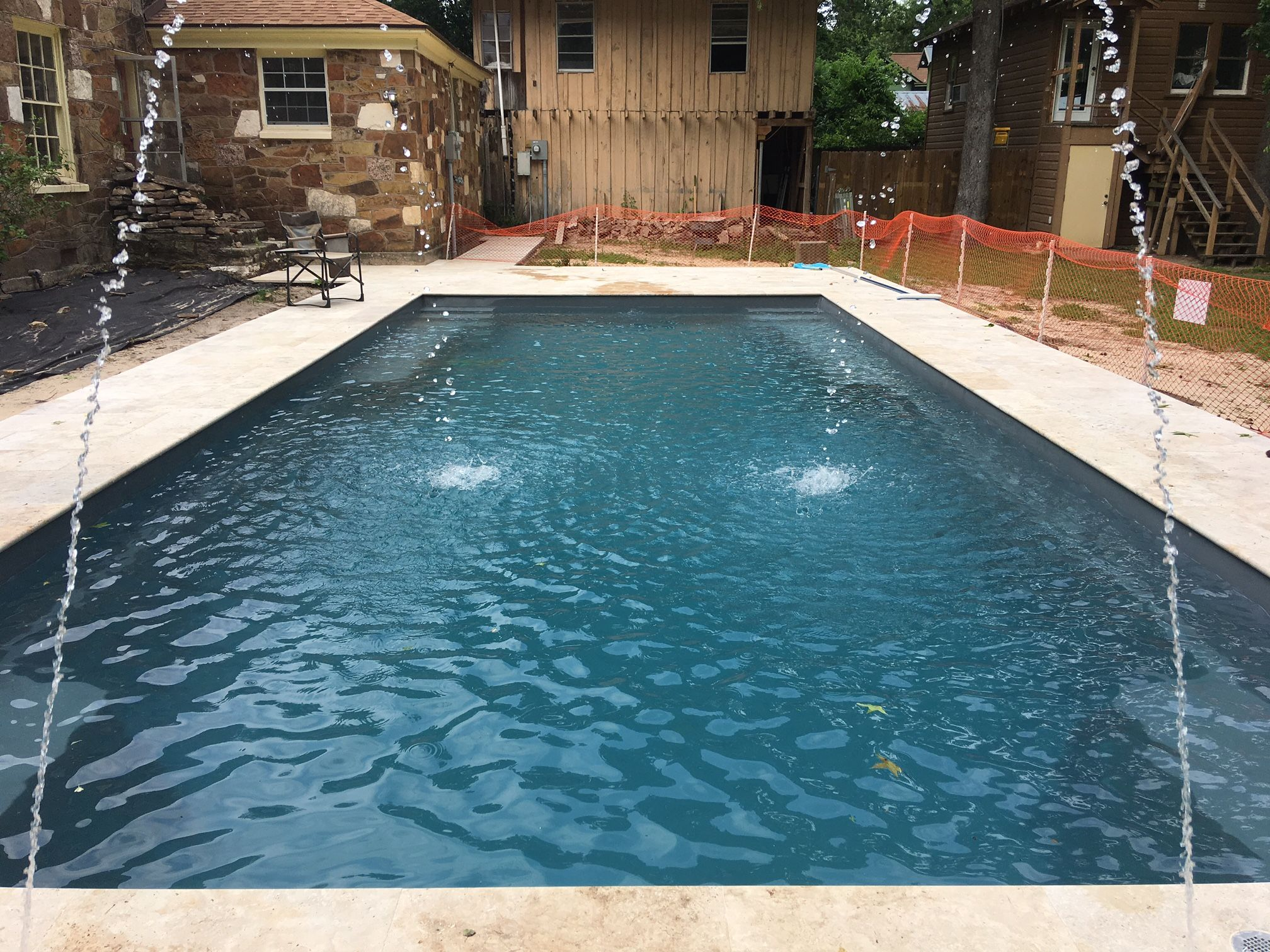One Of Leisure Pools Newest Design Is The Supreme 35 Shown Here In Graphite Grey You Ve Got Entry Steps With Backyard Pool Small Pool Design Leisure Pools