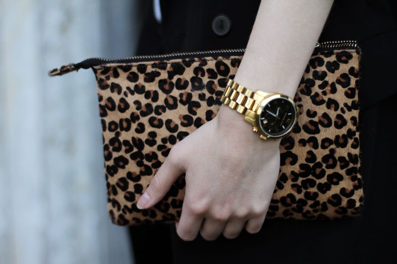 Leopard clutch and a Michael Kors Watch