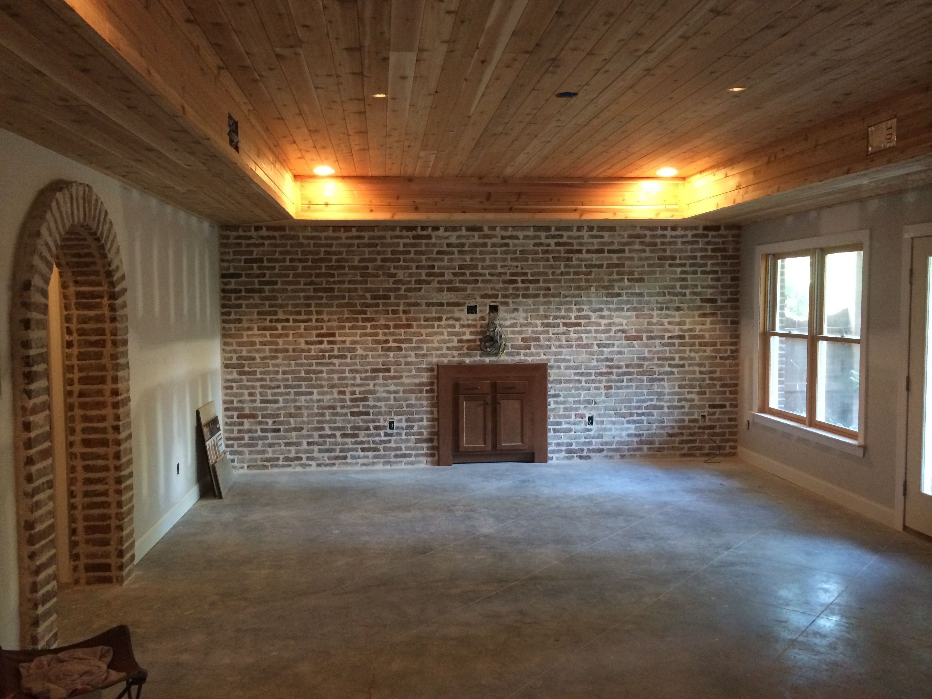 Tongue and groove cedar ceiling with reclaimed brick ...