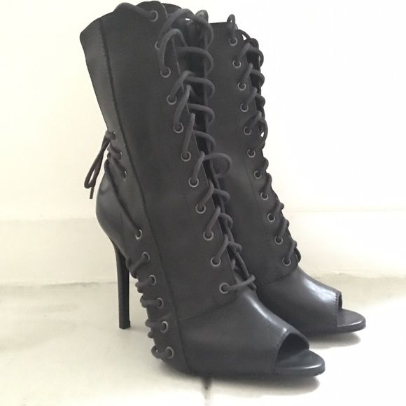 Schutz Lace Up Booties Schutz lace up peep toe booties with multiple tie details. Leather upper, outsole, insole. Never worn. Fits size 8 SCHUTZ Shoes Heeled Boots