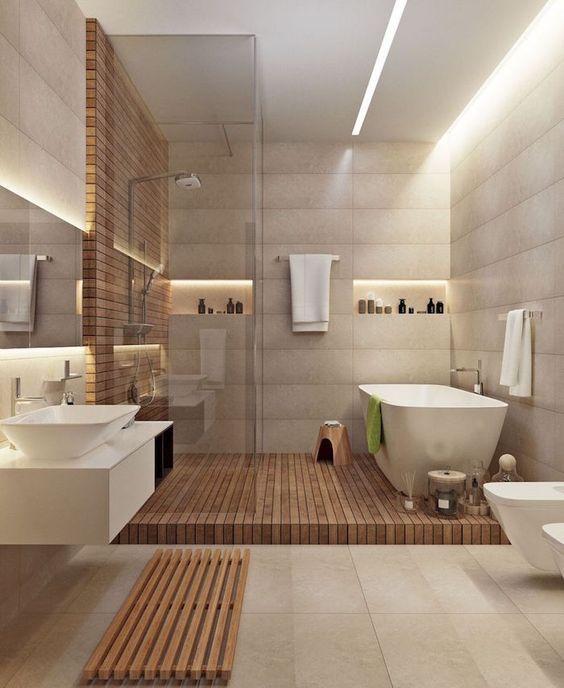 Une salle de bain avec douche et baignoire intégrée façon nordique ...