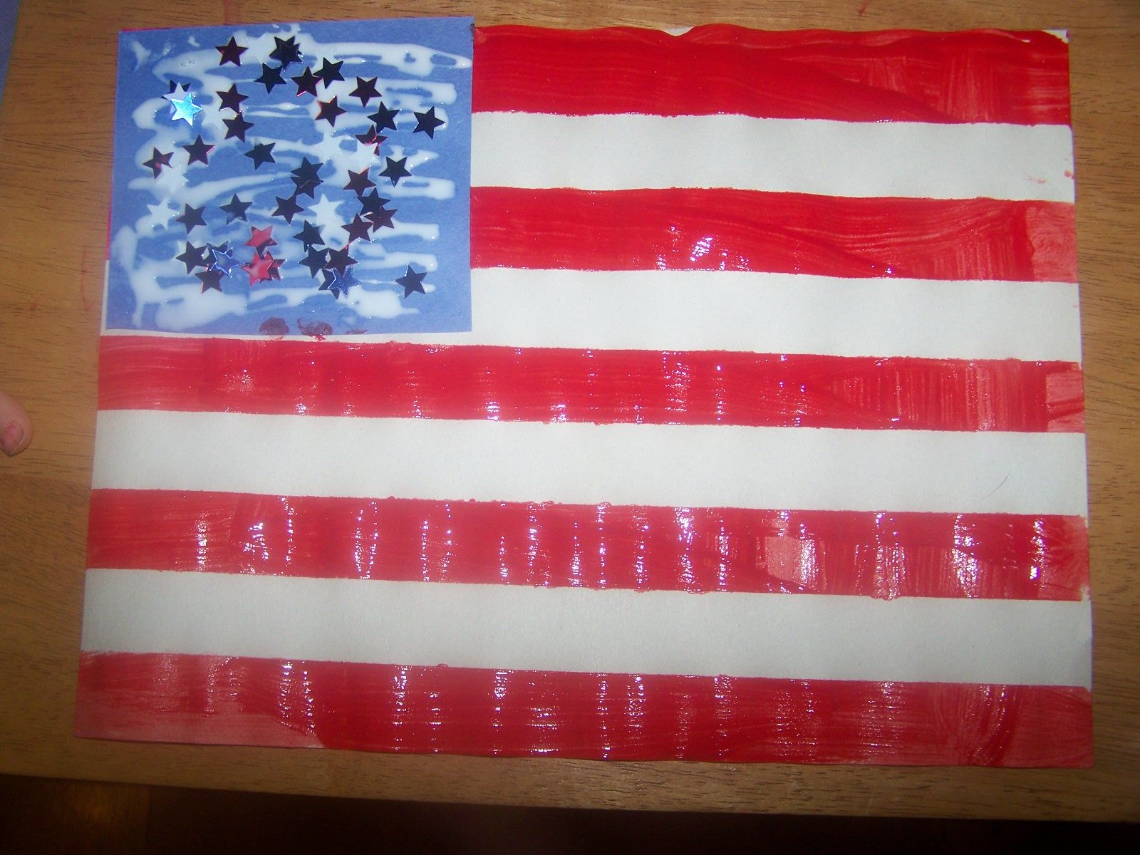 Red White Blue Rice Sensory Table And Flag Made By Painters Tape Lines Then Painting Red Over Whole Sheet Of Pa Memorial Day Flag July Crafts Classroom Crafts
