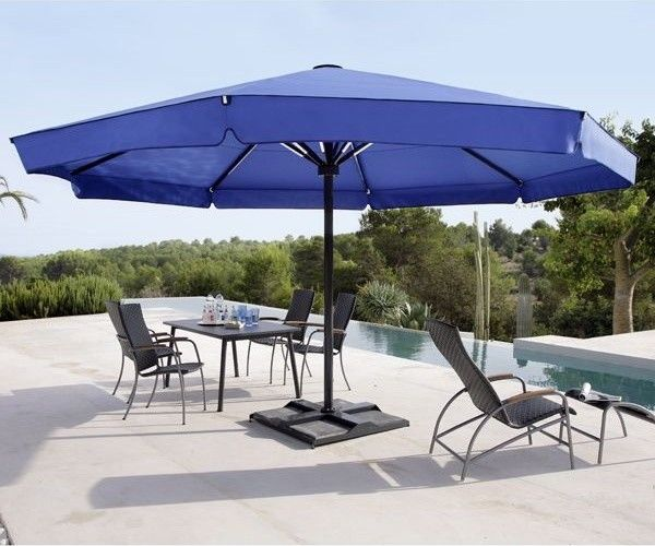 Protecting Our Kids From Uv Rays Or Rain Uhlmann Giant Umbrellas Wherever There Are Kids That Like To Play Outdoors Patio Umbrellas Patio Patio Umbrella