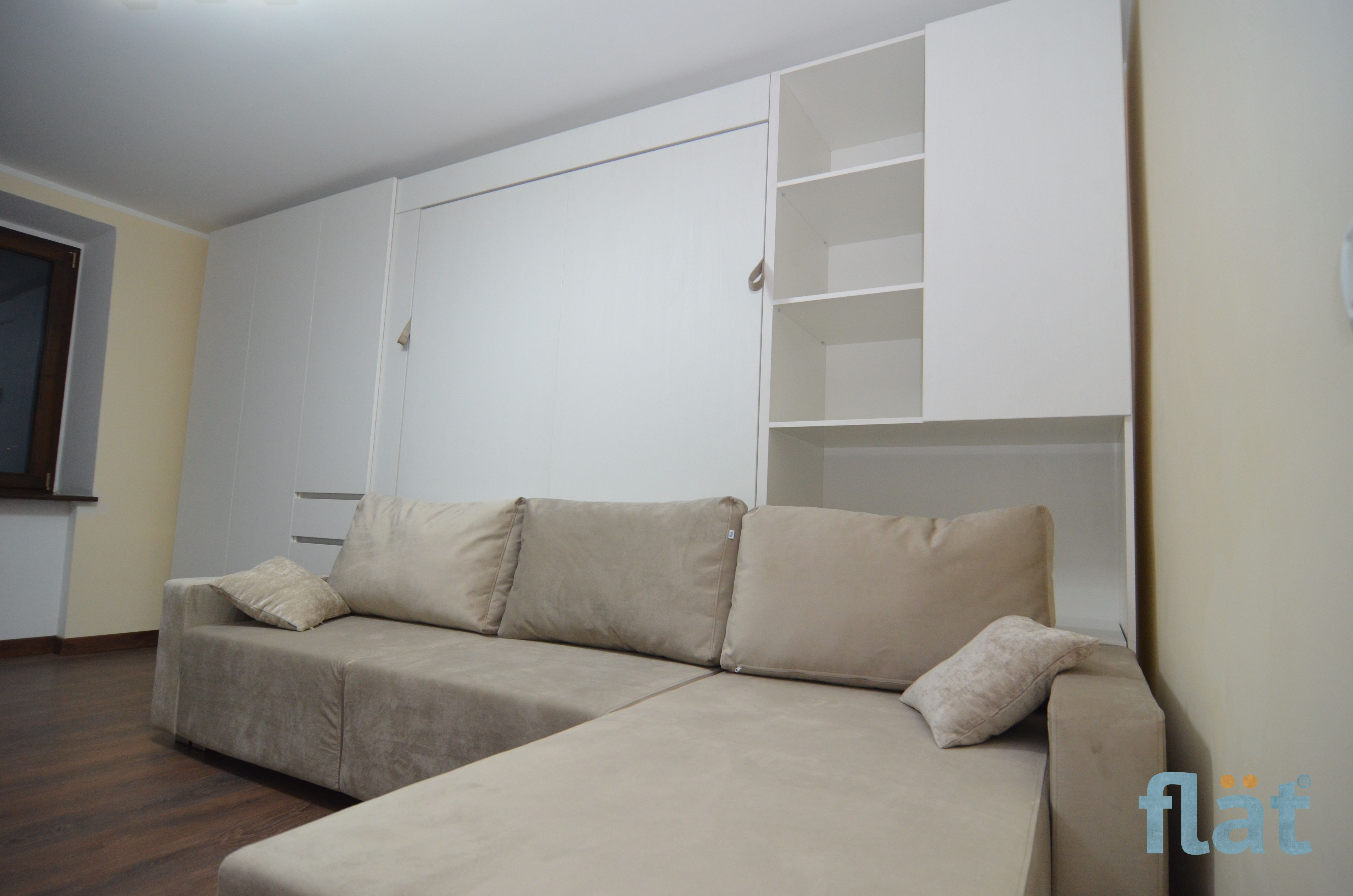 Queen size wall bed with storage and corner sofa. Стена