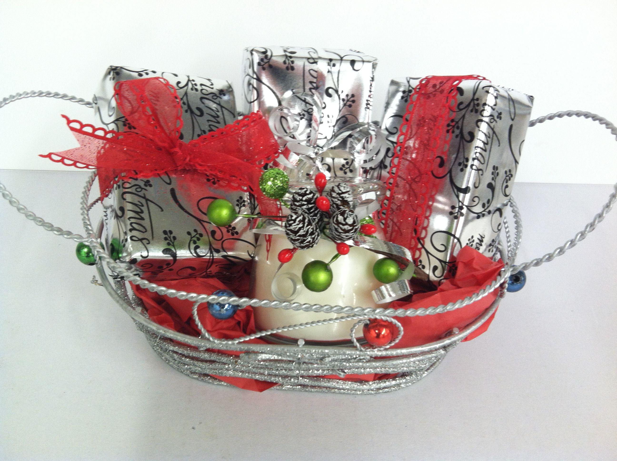 Great gift idea for a friend or I used it for a hostess gift.  A sparkly silver basket.  Homemade soaps wrapped in a great paper and tied up with pretty bows.  I added a highly scented candle that I make.