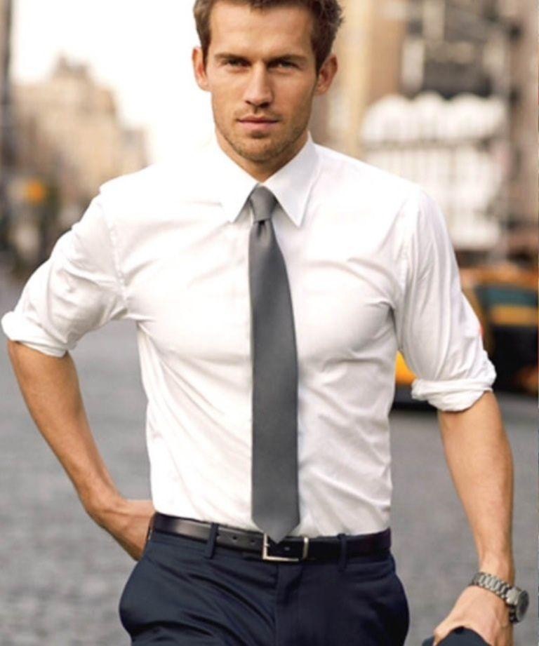 Groomsmen looks: black pants, black belt, black dress shoes, white shirt,