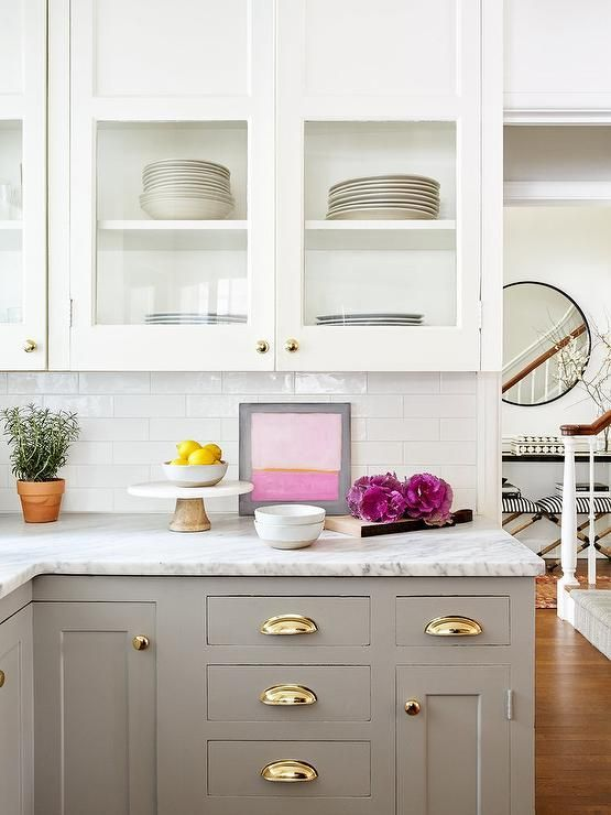 white glass cabinet doors and gold kitchen cabinet hardware beige kitchen cabinets beige on kitchen remodel gold hardware id=80280